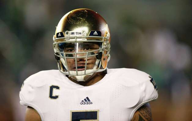 Notre Dame linebacker Manti Te'o looks on during the second half of Notre Dame's 21-6 win over Boston College in a NCAA college football game in Boston Saturday, Nov. 10, 2012. (AP Photo/Winslow Townson) Photo: Winslow Townson, Associated Press / FR170221 AP