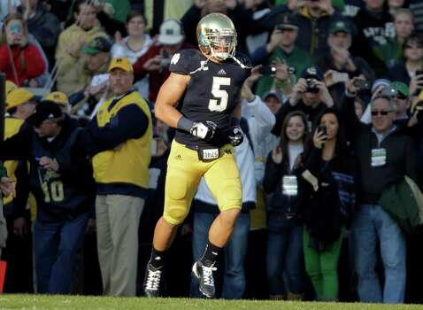 Notre Dame linebacker Manti Te'o takes the field during senior day before an NCAA college football game against Wake Forest in South Bend, Ind., Saturday, Nov. 17, 2012. (AP Photo/Michael Conroy) Photo: Michael Conroy, Associated Press / AP