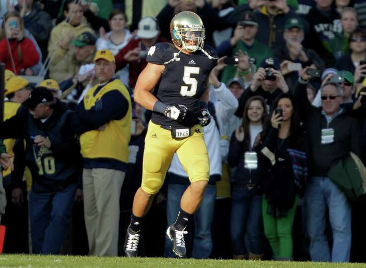 Notre Dame linebacker Manti Te'o takes the field during senior day before an NCAA college football g