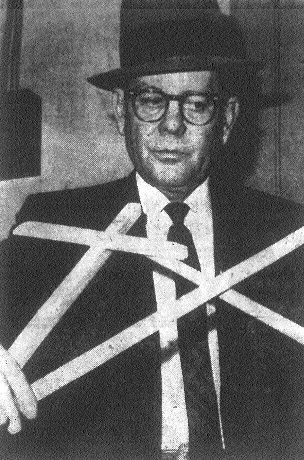 Sheriff's Chief Investigator Tony Morin displays rude crosses vandals made from strips of molding while badly damaging the Presbyterian Church of the Good Shepherd in the Valley-Hi area. The vandalism will delay for at least a week the opening of the nearly-completed church. Published in the San Antonio News Dec. 27, 1962. Photo: File Photo
