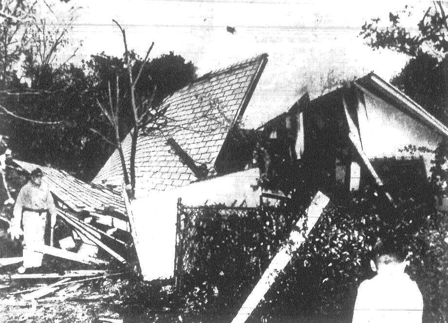 This cottage in the 2100 block of Magnolia was shattered by an explosion resulting from the striking of a match Monday morning. The occupant, Ken Rozell, told firemen he had lighted the oven in the kitchen of his small home about 8 a.m. to make some toast. He said that as the oven ignited he noticed blue flames above the stove, near the ceiling. As he reached to shut off the gas the building exploded. Published in the San Antonio Light Dec. 24, 1962. Photo: File Photo
