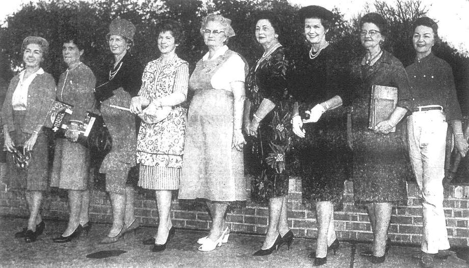 "Pictured here are nine of the 10 selected by reader ballots as ""Outstanding Women of 1962."" Left to right, they are Nessye Scharlack, art; Mrs. Wayne Bull, PTA; Mrs. Alton Walker, church; Mrs. James Castleberry, homemaker; Mrs. William Hering, volunteer; Mrs. Louis Kocurek, hostess; Mrs. James Graves, clubs; Dr. Lois Morrison, career; and Mrs. J.W. Gamblin, gardener. Mrs. Karen Hantza Susman, sports, was en route to a California tennis tournament when the picture was made. Published in the San Antonio Express Dec. 30, 1962. Photo: File Photo"