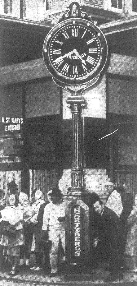 R.D. Kowalik winds the famous Hertzberg clock in preparation for the stroke of midnight on New Year's Eve, the traditional time for crowds to gather under the San Antonio landmark to herald the new year. Published in the San Antonio Express Dec. 31, 1962. Photo: File Photo