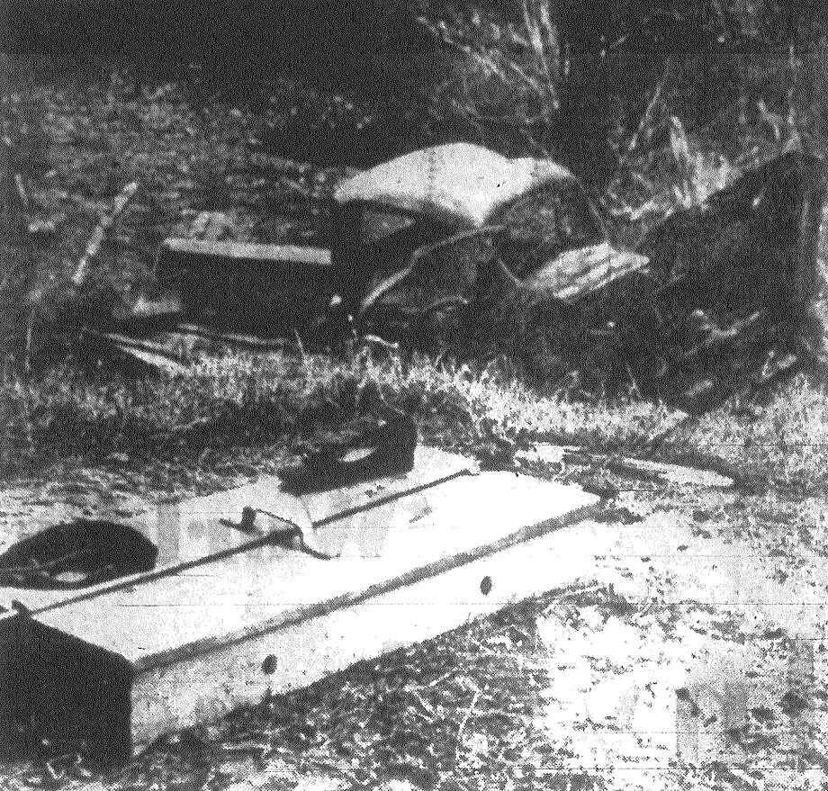 A demolished pickup truck lies at the base of a 50-foot embankment after it was struck by a Southern Pacific train near Floresville. Two people were killed, and two others were critically injured. All were members of the same family. A child's shoe and cap give mute evidence of the collision's severity. Mrs. Anita Ciomperlik of Floresville was the driver of the truck. Published in the San Antonio Light Dec. 30, 1962. Photo: File Photo