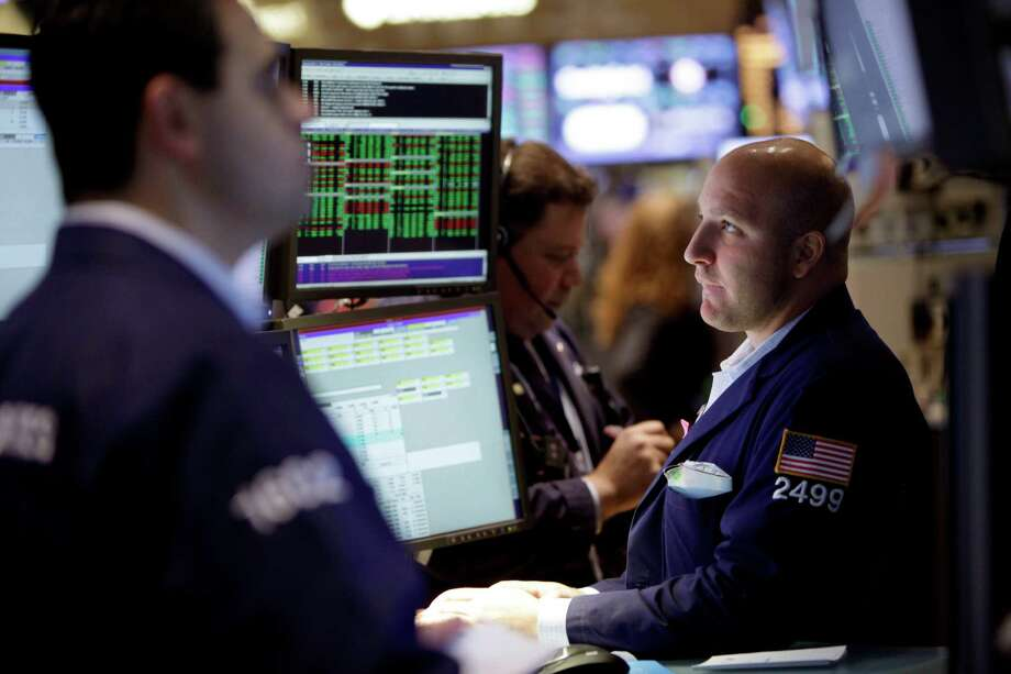 FILE - In this Thursday, Nov. 15, 2012, file photo, Traders work on the floor of the New York Stock Exchange. Stocks are rising in early trading on Wall Street,  Monday, Dec. 3, 2012, following European markets higher, following news that China's manufacturing sector grew last month for the first time in more than a year. (AP Photo/Seth Wenig, File) Photo: Seth Wenig