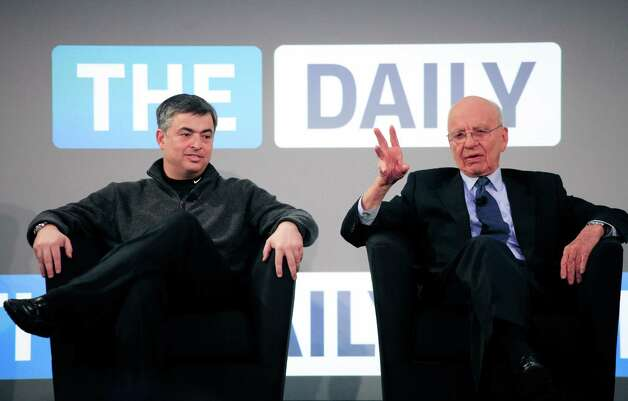 FILE - In this Wednesday, Feb. 2, 2011, file photo, Rupert Murdoch, right, Chairman and CEO of News Corporation, and Eddy Cue, vice president of Apple, attend the launch of The Daily,  in New York. News Corp. said it will cease publication of The Daily, on Dec. 15, 2012.  News Corp. had hoped The Daily would lure both paying subscribers and advertisers to a digital newspaper that included news, gossip and opinion. (AP Photo/Mark Lennihan) Photo: Mark Lennihan