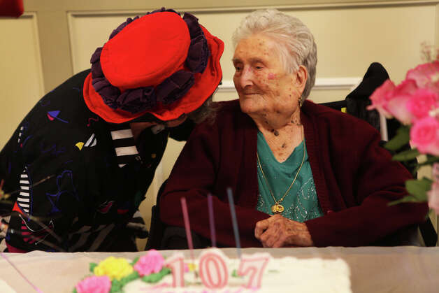 Antonia Mallozzi ,of Stamford, celebrates her 107th birthday at the Minturnese Social Club in Stamford, Conn. on Sunday, December 2, 2012. Photo: BK Angeletti, B.K. Angeletti / Connecticut Post freelance B.K. Angeletti