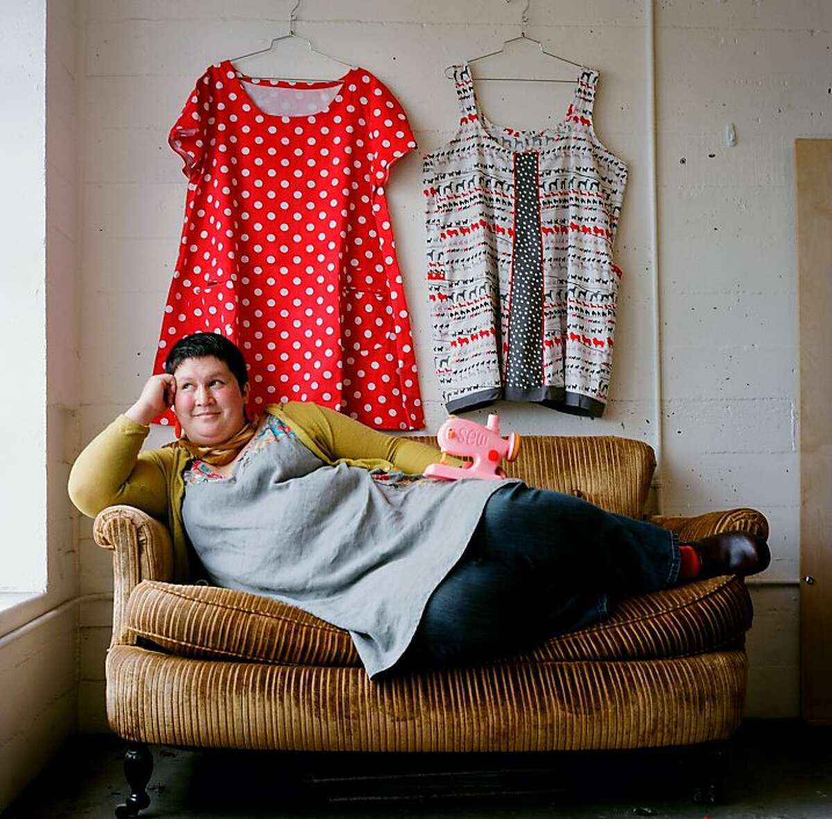 Sonya Philip, who recently sewed 100 dresses in one year, poses in the studio.