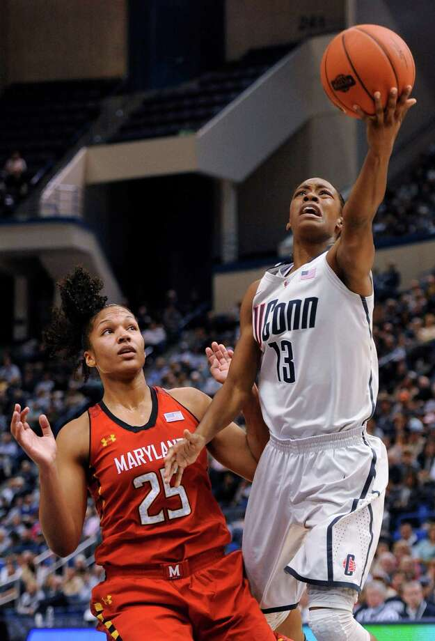 Connecticut's Brianna Banks (13) goes up for a shot while guarded by Maryland's Alyssa Thomas (25) during the first half of an NCAA college basketball game in Hartford, Conn., Monday, Dec. 3, 2012. (AP Photo/Jessica Hill) Photo: Jessica Hill, Associated Press / FR125654 AP