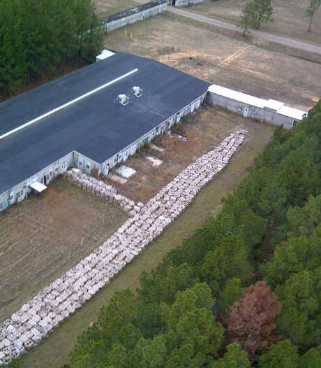 An aerial photo shows part of the smokeless explosive powder improperly stored outside Explo Systems Inc., a munitions dismantling facility in Doyline, La. Photo: HOPD /  Louisiana State Police via The