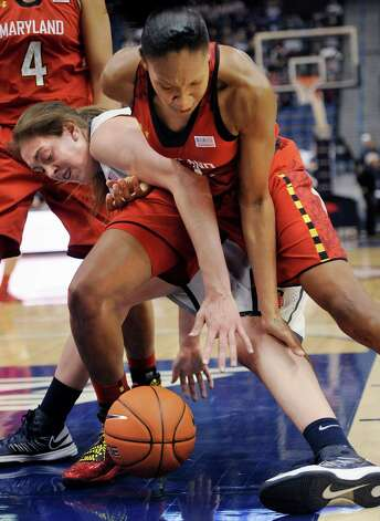Connecticut's Breanna Stewart, left, and Maryland's Alicia DeVaughn, right, fight for control of the ball during the first half of an NCAA college basketball game in Hartford, Conn., Monday, Dec. 3, 2012. (AP Photo/Jessica Hill) Photo: Jessica Hill, Associated Press / FR125654 AP