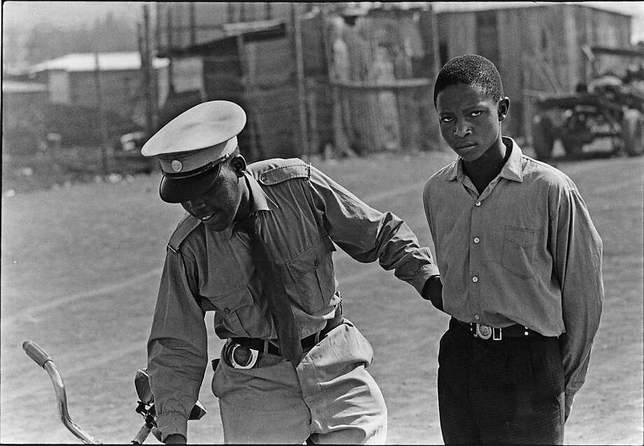 """A student who said he was going to fetch his textbook is pulled in"" (1960/1966), gelatin silver print by Ernest Cole, is part of the apartheid show at San Francisco Museum of Modern Art. Photo: Ernest Cole"