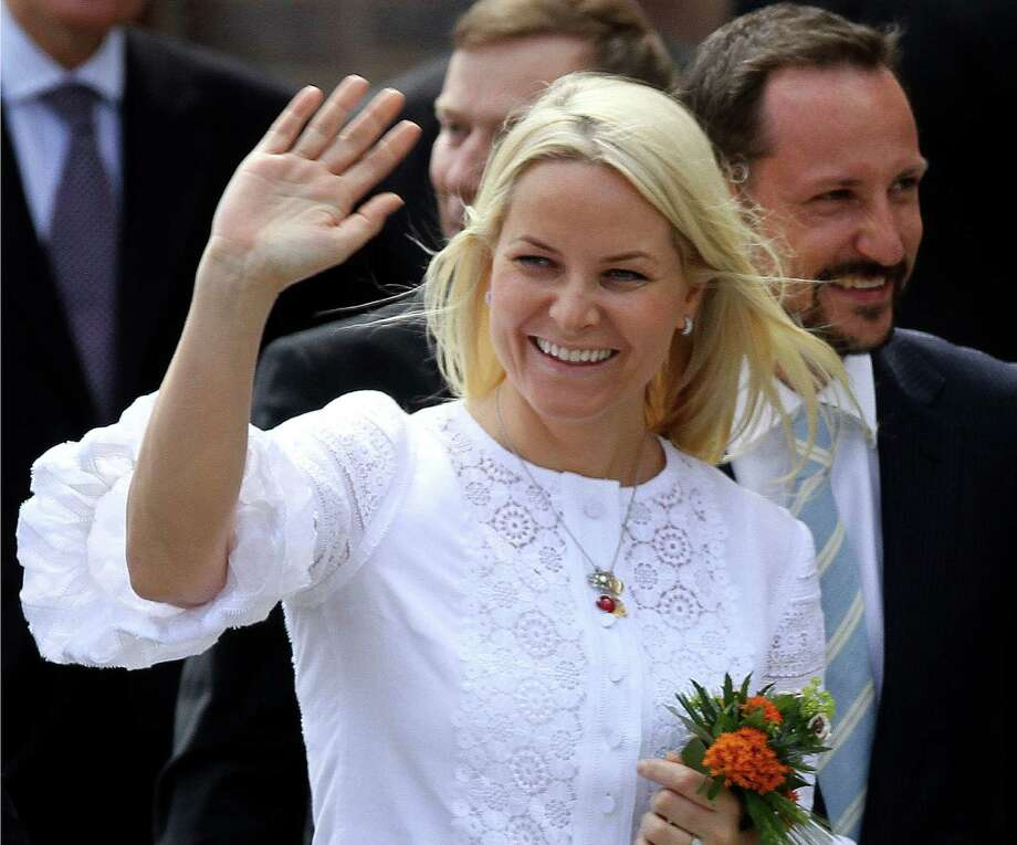 FILE- Norwegian Crown Pricess Mette-Marit and her husband Crown Prince Haakon Magnus, right, wave to the waiting crowd in Stralsund, northern Germany, in this file photo dated Saturday, June 12, 2010.  When friends of Norway's Crown Princess Mette-Marit couldn't travel to India to welcome their surrogate twins into the world, Crown Princess Mette-Marit stepped in and flew to India to look after the twins until the two fathers could fly out, according to Royal Court spokeswoman Marianne Hagen on Monday Dec. 3, 2012,  minding the couple's newly born children and being mistaken by hospital staff for a nanny.  The princess flew to Delhi on Oct. 23, 2012, after visa problems prevented the children's Norwegian parents from arriving at the hospital in time for the birth.(AP Photo/ddp/Michael Urban, File) Photo: Michael Urban, SUB / ddp