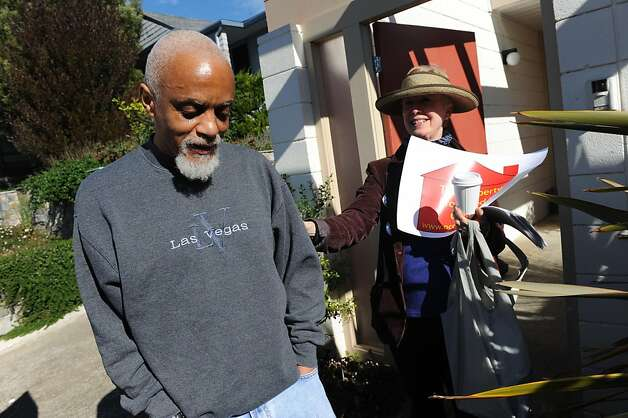 Larry Faulks stands with an unidentified woman Nov. 14 outside the house his parents bought in S.F. in 1962. Photo: Susana Bates, Special To The Chronicle