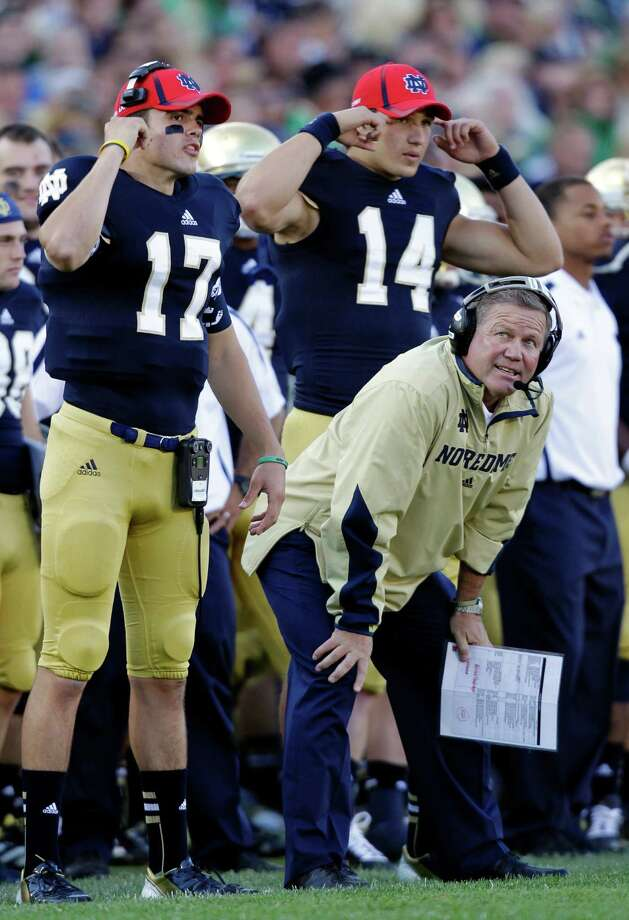 FILE - In this Sept. 8, 2012, file photo, Notre Dame head coach Brian Kelly watches as quarterback Charlie Fiessinger (17) and wide receiver Luke Massa (14) signal in a play during an NCAA college football game against Purdue in South Bend, Ind. All too often last week the Irish offensive line struggled against Purdue, allowing four sacks and rushing for just 53 yards. The linemen are looking for redemption against No. 10 Michigan State's tough defensive line on Saturday.(AP Photo/Michael Conroy, File) Photo: Michael Conroy / AP