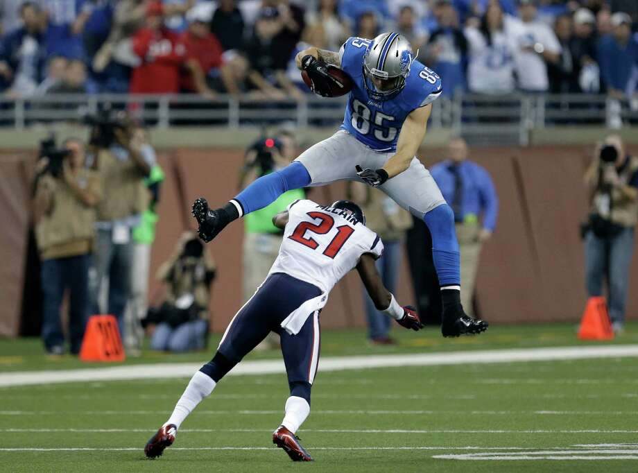Brice McCain, being jumped over by Detroit's Tony Scheffler, broke his foot Sunday and could return if Houston makes the Super Bowl. Paul Sancya/Associated Press Photo: Paul Sancya, Associated Press / AP