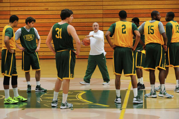 Siena basketball head coach Mitch Buonaguro talks to his players during practice on Tuesday Nov. 27, 2012 in Loudonville, N.Y. The team is getting ready to play Massachusetts at the Times Union Center. (Lori Van Buren / Times Union) Photo: Lori Van Buren / 00020281A
