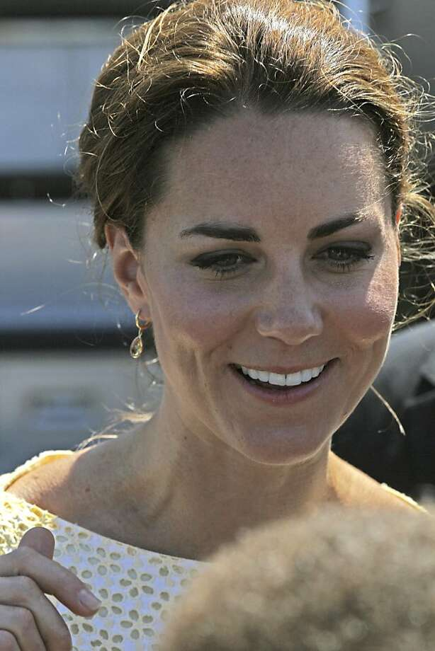 Britain's Kate, the Duchess of Cambridge, smiles as she and Prince William prepare to depart Honiara, Solomon Islands, Tuesday, Sept. 18, 2012, after an official visit to the South Pacific Island nation.  (AP Photo/Rick Rycroft) Photo: Rick Rycroft, Associated Press