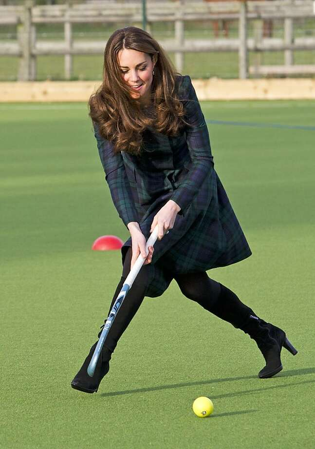 "Kate, the Duchess of Cambridge, plays hockey during her visit to St. Andrew's School, where she  attended school from 1986 till 1995, in Pangbourne, England, Friday, Nov. 30, 2012. The Duchess of Cambridge has gone back to school. The royal, formerly known as Kate Middleton, played hockey and revealed her childhood nickname — Squeak — when she returned to her elementary school for a visit Friday. Kate told teachers and students at the private St. Andrew's School in southern England that her 10 years there were ""some of my happiest years."" She said that she enjoyed it so much that she had told her mother she wanted to return as a teacher. (AP Photo/Arthur Edwards, Pool) Photo: Arthur Edwards, Associated Press"