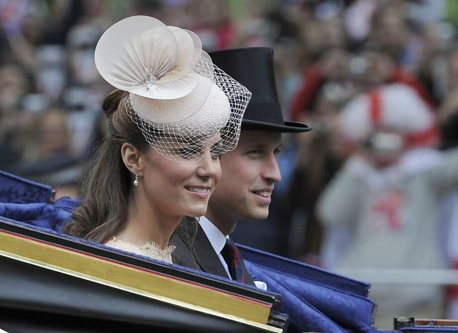 Britain's Prince William and Kate Duchess of Cambridge pass along The Mall as part of a four-day Diamond Jubilee celebration to mark the 60th anniversary of  Queen Elizabeth's  accession to the throne, London, Tuesday, June, 5, 2012. (AP Photo/Tom Hevezi, Pool) Photo: Tom Hevezi, Associated Press
