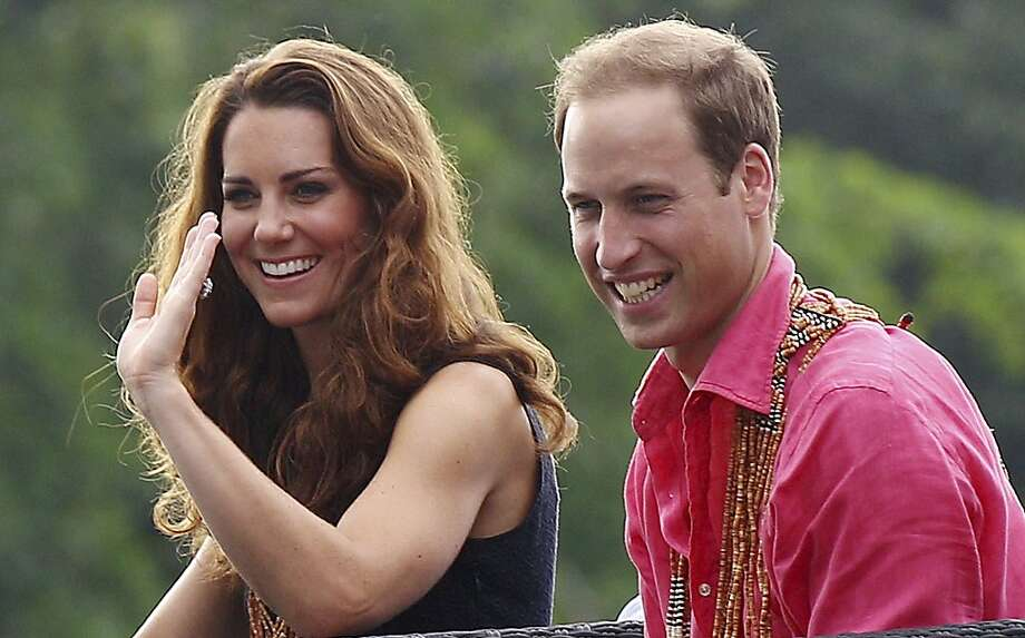 Britain's Prince William and his wife Kate, the Duke and Duchess of Cambridge, smile as they watch a shark ceremony as they arrive at Marapa Island, Solomon Islands, Monday, Sept. 17, 2012. (AP Photo/Rick Rycroft, Pool) Photo: Rick Rycroft, Associated Press