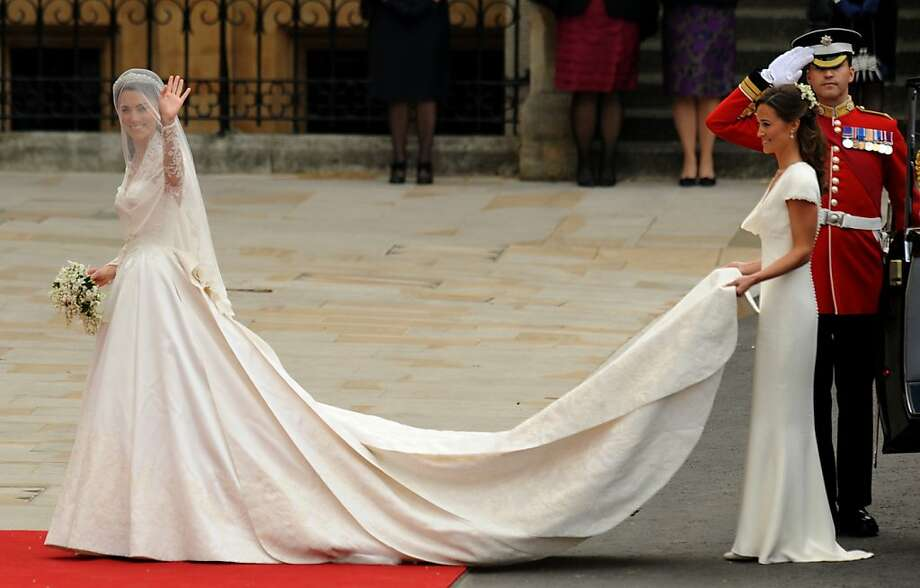Kate Middleton (L) waves as she arrives with her sister, the Maid of Honour Philippa Middleton at the West Door of Westminster Abbey in London for her wedding to Britain's Prince William, on April 29, 2011.   AFP PHOTO / BEN STANSALL (Photo credit should read BEN STANSALL/AFP/Getty Images) Photo: Ben Stansall