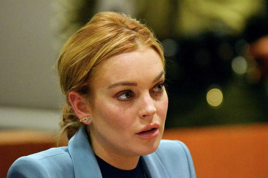 Lindsay Lohan: Though she's finally off the hook for myriad other legal troubles, Lohan is still working to resolve a dispute over unpaid 2009 and 2010 taxes. The starlet reportedly owes over $200,000. Photo: Pool, Getty Images / 2012 Getty Images