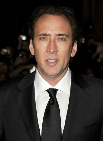 Nicolas Cage: In 2010, the actor told People magazine that he owed $14M in back taxes. At present, he is said to have paid around $7M of it back. Photo: Jason Merritt, Getty Images / 2011 Getty Images