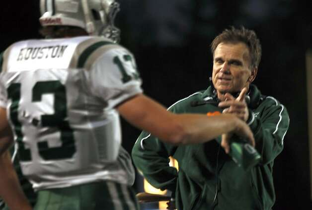 Bob Ladouceur head coach of De La Salle's nationally renowned football team, talks one on one with one of his players on the sideline during their game with Foot Hill high school Friday October 7, 2011. Photo: Lance Iversen, The Chronicle