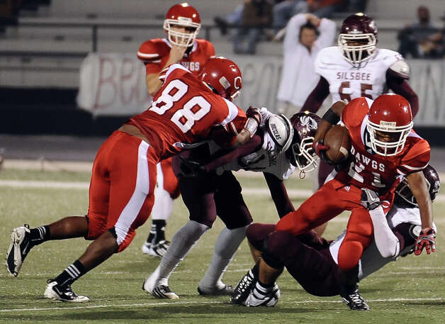 Carthage running back Bryian Bolton, 21, is sacked during the Carthage High School Class 3A Division II state quarter finals game against Silsbee High School at the Abe Martin Stadium in Lufkin on November, 30, 2012. Photo taken: Randy Edwards/The Enterprise