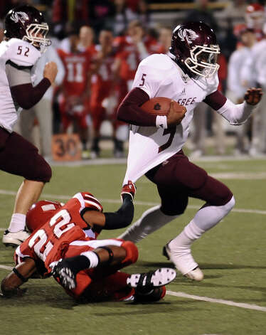 Silsbee quarterback Patrick Reed, 5, with a quarterback keeper during the Carthage High School Class 3A Division II state quarter finals game against Silsbee High School at the Abe Martin Stadium in Lufkin on November, 30, 2012. Photo taken: Randy Edwards/The Enterprise