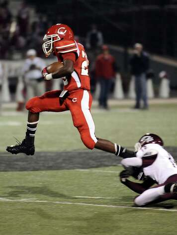 Carthage running back Tevin Pipkin, 25, charges down the field for another Bulldog first down during the Carthage High School Class 3A Division II state quarter finals game against Silsbee High School at the Abe Martin Stadium in Lufkin on November, 30, 2012. Photo taken: Randy Edwards/The Enterprise