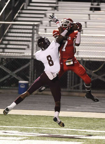 Carthage wide receiver O'keeron Rutherford, 7, makes a catch in the end-zone during the Carthage High School Class 3A Division II state quarter finals game against Silsbee High School at the Abe Martin Stadium in Lufkin on November, 30, 2012. Photo taken: Randy Edwards/The Enterprise