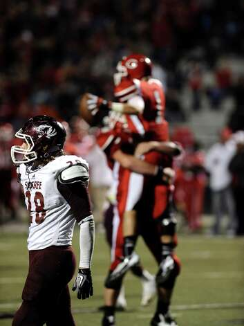 Silsbee senior linebacker Karl Elers, 28, walks off the field after Carthage scores for the fourth time before the half during the Carthage High School Class 3A Division II state quarter finals game against Silsbee High School at the Abe Martin Stadium in Lufkin on November, 30, 2012. Photo taken: Randy Edwards/The Enterprise Photo: Randy Edwards