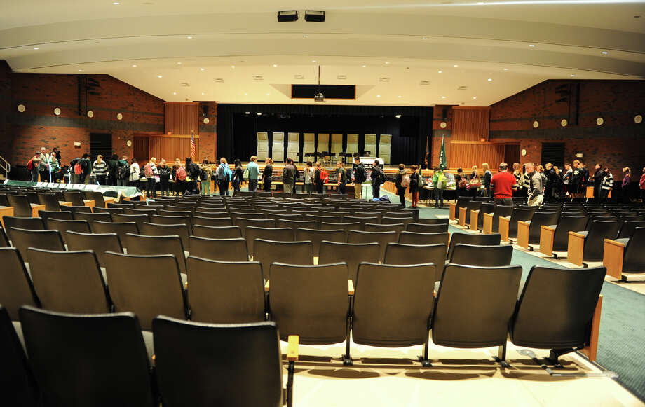 Students and faculty line up at a memorial set up in the auditorium at Shenendehowa High School Monday Dec. 3, 2012 in Clifton Park, N.Y. The memorial is set up for students to grieve together, to leave notes and flowers to honor the lives of Chris Stewart and Deanna Rivers, and to offer wishes for the emotional and physical recovery of Matt Hardy and Bailey Wind. (Lori Van Buren / Times Union) Photo: Lori Van Buren