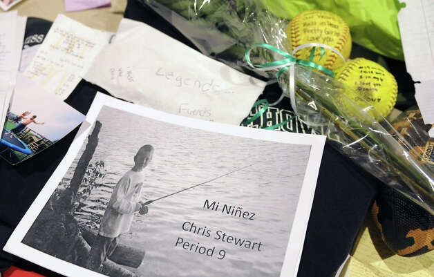 Memorabilia from Chris Stewart and Deanna Rivers at a memorial set up in the auditorium at Shenendehowa High School Monday Dec. 3, 2012 in Clifton Park, N.Y. The memorial is set up for students to grieve together, to leave notes and flowers to honor the lives of Chris Stewart and Deanna Rivers, and to offer wishes for the emotional and physical recovery of Matt Hardy and Bailey Wind. (Lori Van Buren / Times Union) Photo: Lori Van Buren