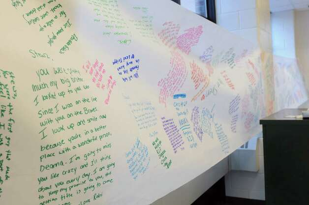 A banner hangs in the hallway which students signed for Chris Stewart and Deanna Rivers outside the auditorium at Shenendehowa High School Monday Dec. 3, 2012 in Clifton Park, N.Y. A memorial was set up in the auditorium for students to grieve together, to leave notes and flowers to honor the lives of Chris Stewart and Deanna Rivers, and to offer wishes for the emotional and physical recovery of Matt Hardy and Bailey Wind. (Lori Van Buren / Times Union) Photo: Lori Van Buren