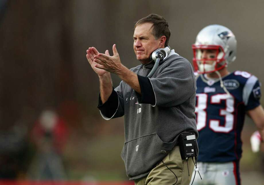 In this Dec. 4, 2011 file photo, New England Patriots head coach Bill Belichick applauds his team's performance during their NFL football game against the Indianapolis Colts,  in Foxborough, Mass. Big game or just another regular-season matchup, Belichick believes in consistency as a cornerstone of his coaching. Photo: Elise Amendola, STF / AP2011