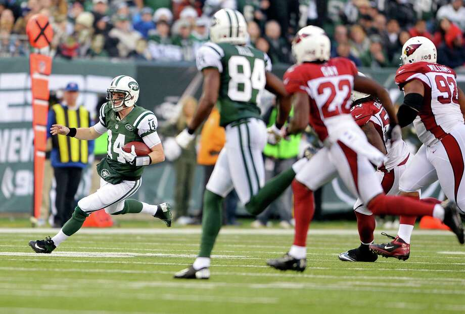 New York Jets quarterback Greg McElroy (14) runs the ball during the fourth quarter of an NFL game against the Arizona Cardinals at MetLife Stadium in East Rutherford, N.J., Dec. 2, 2012. The Jets won 7-6. (Ben Solomon/The New York Times) Photo: BEN SOLOMON / NYTNS