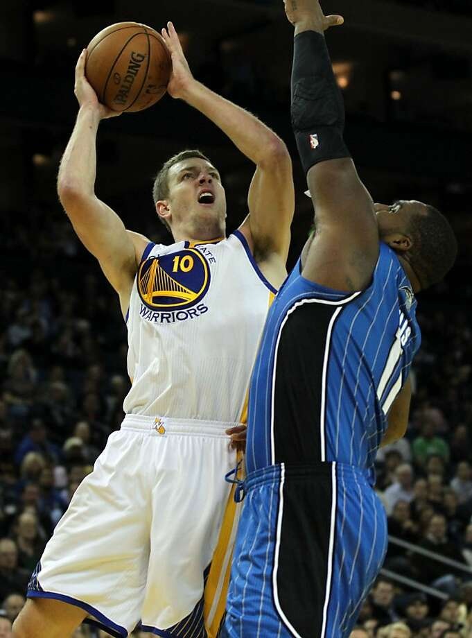 Golden State Warriors' David Lee (10) shoots over Orlando MagicÕ Glenn Davis (11) during the first half of an NBA basketball game in Oakland, Calif., Monday, Dec. 3, 2012 Photo: Lance Iversen, The Chronicle