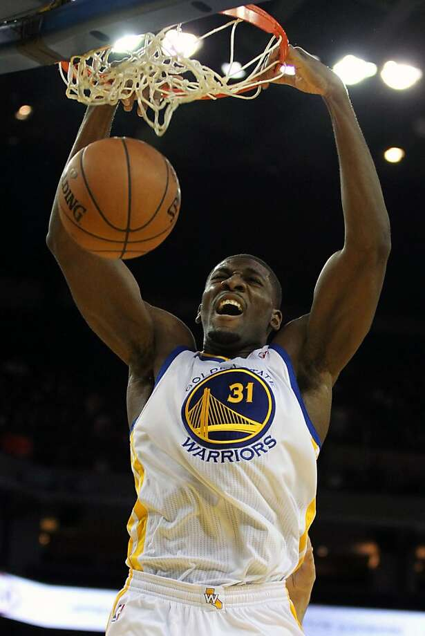 Golden State Warriors' Festus Ezeli (31) dunks the ball against the Orlando Magic during the first half of an NBA basketball game in Oakland, Calif., Monday, Dec. 3, 2012 Photo: Lance Iversen, The Chronicle