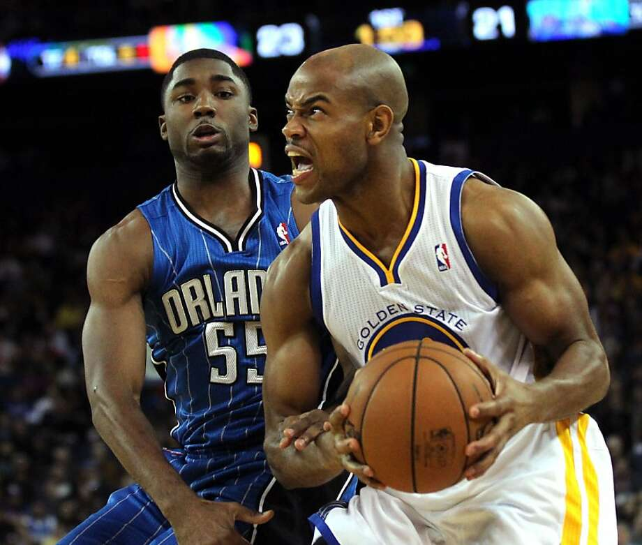 Golden State Warriors' Jarrett Jack (2) drives to the basket in front of Orlando MagicÕ E'Twaun Moore (55) during the first half of an NBA basketball game in Oakland, Calif., Monday, Dec. 3, 2012 Photo: Lance Iversen, The Chronicle