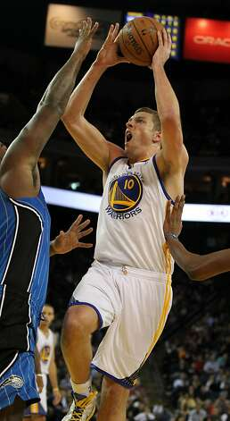 David Lee, who scored 22 points, shoots over Orlando forward Glen Davis. Photo: Lance Iversen, The Chronicle