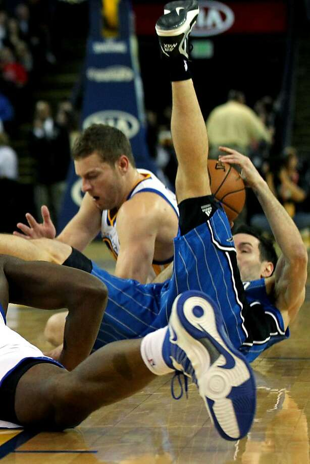 Golden State Warriors' Davis Lee (10) battles Orlando Magic's J.J. Redick for control of a loose ball during the first half of an NBA basketball game in Oakland, Calif., Monday, Dec. 3, 2012 Photo: Lance Iversen, The Chronicle