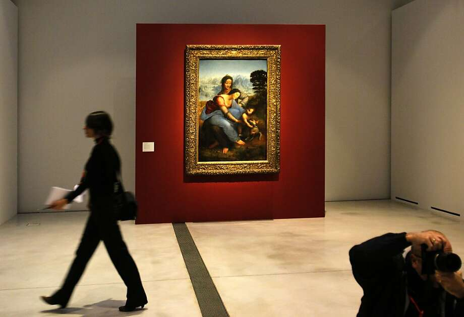 "A woman walk past ""La Vierge, l'Enfant Jesus et Sainte Anne"" by Leonard de Vinci in the Louvre Museum in Lens, northern France, Monday, Dec. 3, 2012. The museum in Lens, to open the 12 Dec, is part of a strategy to spread art beyond the traditional bastions of culture in Paris. Photo: Michel Spingler, Associated Press"