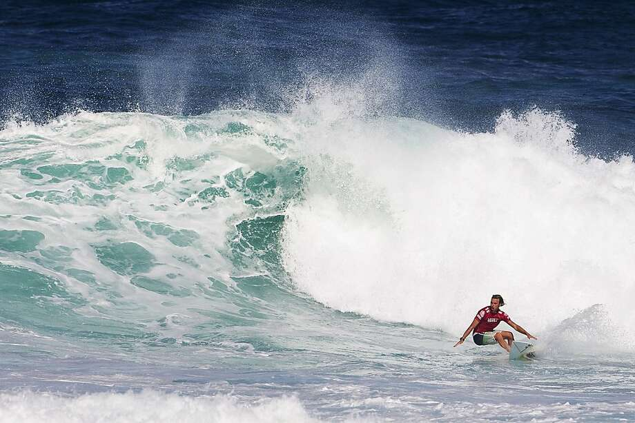 In this photo provided by Association of Surfing Professionals, Adrian Buchan, of Australia, competes on his way to advancing during the Vans World Cup of Surfing, Monday, Dec. 3, 2012, at Sunset Beach near Haleiwa, Hawaii. Photo: Kirstin Scholtz, Associated Press