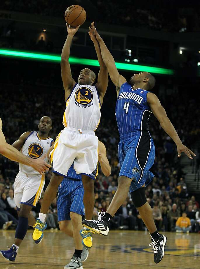 Golden State Warriors' Jarrett Jack (2) shoots over Orlando MagicÕ Arron Afflalo (4) during the second half of an NBA basketball game in Oakland, Calif., Monday, Dec. 3, 2012, Magic won 102-94. Photo: Lance Iversen, The Chronicle
