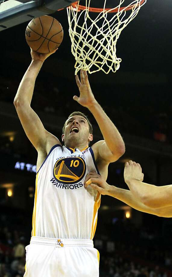 Golden State Warriors' Davis Lee (10) scores on a dunk shot against the Orlando MagicÕ during the second half of an NBA basketball game in Oakland, Calif., Monday, Dec. 3, 2012, Magic won 102-94. Photo: Lance Iversen, The Chronicle
