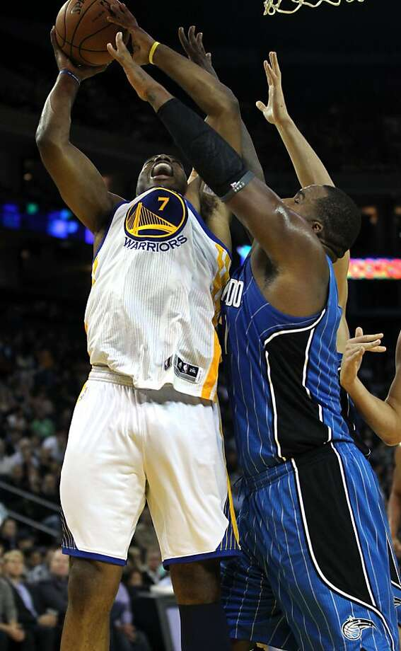 Golden State Warriors' Carl Landry (7) shoots over Orlando MagicÕ Glenn Davis (11) during the first half of an NBA basketball game in Oakland, Calif., Monday, Dec. 3, 2012 Photo: Lance Iversen, The Chronicle