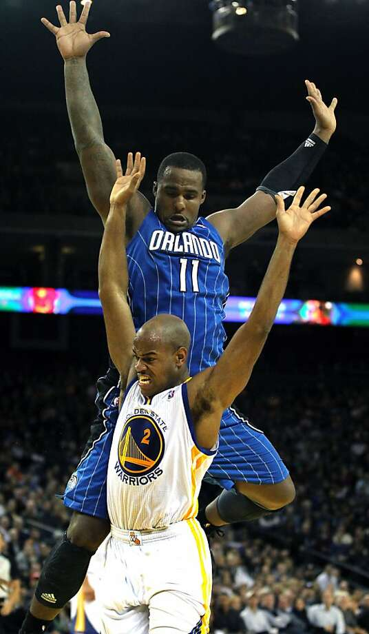 Golden State Warriors' Jarrett Jack (2) is stripped of the ball by Orlando MagicÕ Glenn Davis (11) during the second half of an NBA basketball game in Oakland, Calif., Monday, Dec. 3, 2012, Magic won 102-94. Photo: Lance Iversen, The Chronicle